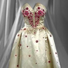 Silk dupion gown, Worth of London, about 1955. Museum no. T.214-1973. Given by Mrs Roy Hudson