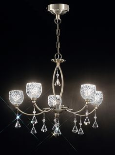 FL2293/5 Sherrie 5 light pendant or flush fitting bronze with crystal drops. Bronze finish fitting with small cut glass shades and faceted crystal drops. The fitting is suplied with chain suspension but is easily converted to a semi-flush fitting suitable for low ceilings. Supplied with Osram G9 mains voltage halogen bulbs which are suitable for dimming. 5 x 33w G9 Lamps included Height- 102cm Minimum Height- 43cm Diameter- 52cm BRAND: Franklite REFERENCE- FL2293/5 AVAILABILITY: 3-4 Working…