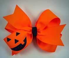 Pumpkin face hair bow neon orange hair bow fall by Kellyskrafts37