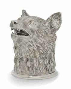 A SMALL RUSSIAN CAST SILVER STIRRUP CUP IN THE FORM OF A FOX HEAD -   MARK OF NIKOLS AND PLINKE, ST. PETERSBURG, CIRCA 1860 -   Gilt interior,  3 in. high (7.5 cm.)  7.25 oz. (225 gm.)