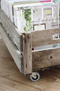 Rustic crate with casters for magazine storage...do this with the old peach crate I have and put in living room