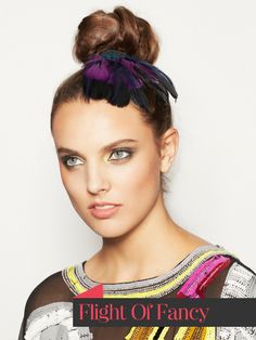 "Super easy ""messy topknot"" dressed up with some pretty plumage."