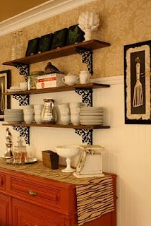 Love the shelves and items. Shelf brackets from Hobby Lobby.