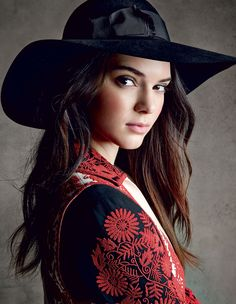 Kendall Jenner in a black-and-white jacket with micro-beading in a bold shade of crimson by Valentino. Saint Laurent by Hedi Slimane hat. Photographed by Patrick Demarchelier, Vogue, December 2014.