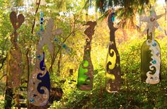 Wine Bottle Sun Catcher - Wine bottles melted in my kiln, then I cut recycled duct work into designs I attach to the bottle. A little glass beading is added to the hanging wire - and presto a lovely up-cycled good for the earth green piece of art. ($45.00)