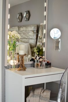 Lots of HomeGoods finds in this beautiful dressing area & vanity ...