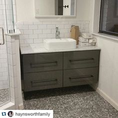 The flip was just cleaned and it feels so good to see everything without 37 layers of construction dust and debris! #IGTBHflip10 #bathroomremodel #wholehouserenovation #pennytile #ikeavanity #floatingvanity #ikeahack #vesselsink #repost