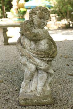 Cast stone putti representing the season of winter. #antique #stone