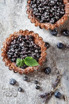 Pic: Homemade blueberry pie with mint and lavender. gray stone table