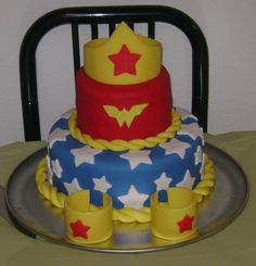 Wonder Woman Cake Made this for my birthday this past weekend. All my friends loved it!Made the tiara and bracelets by wrapping wax paper...