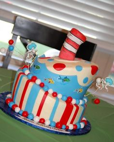 Dr Seuss cake iced in buttercream with mmf accents.fish and thing 1 and 2 are cut out edible images and hat is made from rice crispy treats covered in gumpaste Cupcakes, Cupcake Cakes, Dr Seuss Cake, Dr Suess, Cake Pops, Cupcake Diaries, Fancy Cakes, Cake Creations, Amazing Cakes