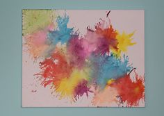 crayon.  the smaller the piece the more it splatters.  for bigger blobs of color use a bigger piece.  SO FUN!