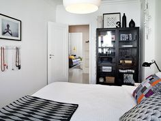Black cabinet, white walls.