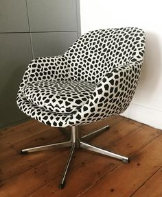 Reupholstered desk chair in funky fabric.