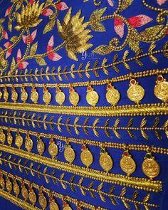 Details of our detailing - Coin work blouse in the making at YUTI! For Price and Other details reach us at 044-42179088 or Whatsapp: 7010905260 Address: 21, Valmiki street, Thiruvanmyur, Chennai.  handembroidery #blue #bridalblouse  #weddingblouse #bridal #anarkali #lotusembroidered #elbowsleeves #coinwork #kasumala #goldcoins #bridalblousework #blouseembroidery #silkthreads #kundanwork #zardosiwork #antique #floorlengthanarkali #bridalblousedesign #chennaidesigner #embroidery #happyclient…
