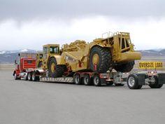 CAT 440 scrapper on 3 axle RGN axle stinger on nitrogen system. Caterpillar Toys, Big Trucks, Semi Trucks, Medford Oregon, Road Train, Semi Trailer, Peterbilt, Heavy Equipment, Volvo