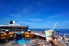 Cheers! Pina colada and pool deck aboard the Norwegian Star cruise ship to introduce our top 50 cruise hacks and cruise tips