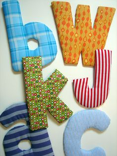 DIY Super easy, cheap fabric letters  @Judith Zissman Zissman Halvorson Could be fun for baby's room. Inexpensive, and tons of options with fabric!