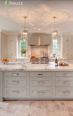 love the windows, color and style of island, two side deep cabinets that hide larger appliances