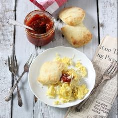 Tomato jam on a southern style biscuit with scrambled eggs and cheese {recipe}