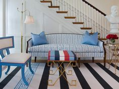 "If you follow fashion trends, you may have noticed navy is one of the hottest ""new neutrals."" Just like black, white and gray, navy can create a statement without overpowering a room. Pair it with bold colors, such as red or pink, to create style-setting combos. Want to follow the nautical trend? Consider using it in a striped pattern like the rug shown here."