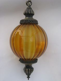 Photo of Retro groovy 60s vintage swag lamp, hanging light w/ amber glass globe #1