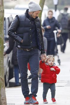 Daddys little princess: David enjoying some quality time with daughter Harper in London last week