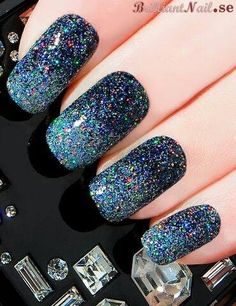 this can be done with a small glittler, after u put it, cover it with shine :)