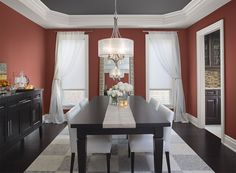 intensely red dining room - moroccan spice AF-285 (walls), stormy sky 1616 (ceiling), distant gray 2124-70 (trim)