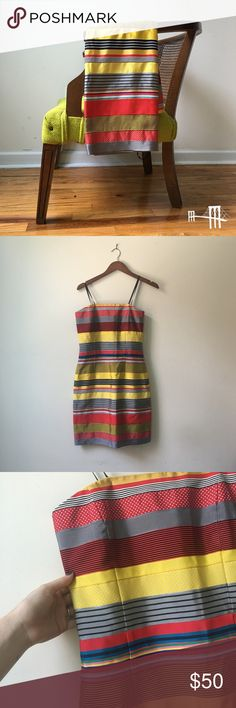🎉⛱HP!⛱🎉 🏷 NWT J. McLaughlin Ribbon Dress NWT! 🏷 Bright and sunny ribbon dress from J.McLaughlin. Absolutely stunning fabric. Bodice has ribs for structure, invisible zipper in back. One of the black ribbons used to hang the dress has detached, but it does not affect the actual dress.   Don't like the price? 💸 Make me an offer with the button below! 👇🏻 J. McLaughlin Dresses Strapless