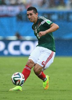 Hector Herrera of Mexico controls the ball during the 2014 FIFA World Cup Brazil Group A match between Mexico and Cameroon at Estadio das Dunas on June 13, 2014 in Natal, Brazil.