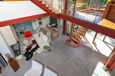 """Staircase on I-beam rails - Notice concrete floors and stone """"first step"""" on staircase"""