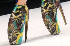 Alexander McQueen poses the question, 'Who needs to walk normally when you can wear patterned clogs en pointe?'