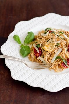 Easy weeknight dinner of pasta with sun-dried tomatoes, artichokes, and fresh herbs.