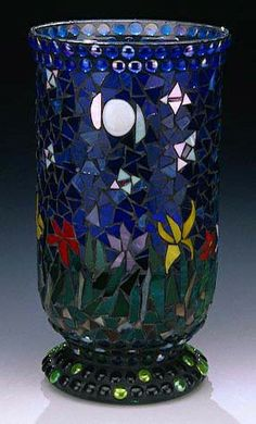 © Manon Doyle - Mosaic Vase. Doyle's mosaics are all created from glass. She favors glass because of the large variety of colors, & she will often mix beads, mirror, millefiori, & smalti.