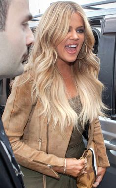 <p>The reality star is all smiles as she waves at a security officer.</p>