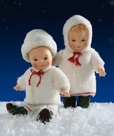 "RJW - : Winter Frolics fully jointed 6 3/4"" toddlers made of felt with hand painted features. Dressed in wool plush snowsuits encrusted with snow. On their feet are tiny hand cobbled leather shoes and felt spats. Date of Release: 2007 Part of the Snowbaby Collection. Limited Edition: 50 sets. Made exclusively for The Toy Shoppe, Richmond, VA."