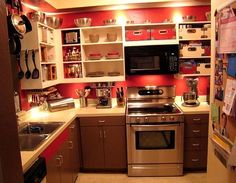 He chose to go decidedly darker and redder for his makeover. He removed the upper cabinet doors and painted the lower. (The SS stove doesn't hurt either.)