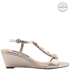 This Swarovski crystal embellished wedge is a perfect shoe to add glamour to any outfit from jeans to your favorite dress. Toe Shape: Almond Upper Material: Metallic Leather Lining Material: Leather Entry: Adjustable Buckle Heel Height: Imported Nina Shoes, Toe Shape, Pumps, Heels, Metallic Leather, Swarovski Crystals, Platform, Wedges, Glamour