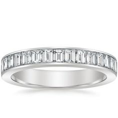 This stunning band features a row of baguette cut diamonds secured in a channel that extends halfway down the shank for eye-catching sparkle. Available in Platinum.