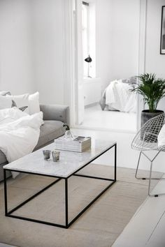Marble table in white and grey in a modern livingroom
