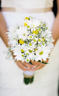 a bouquet full of daises is a sweet choice for a spring bride - thereddirtbride.com - see more of this wedding here