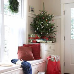 Place a Charlie Brown sized tree in a nook and a few gifts below to bring the scents of the season minus the elaborate efforts.