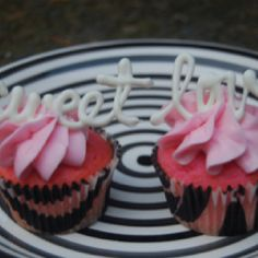 Pink champagne cupcake with champagne frosting, raspberry filling and white chocolate garnish. Yumm!