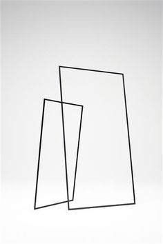 simple and minimal hangar rack: black frames | wardrobe . Garderobe . garde-robe | Design: nendo |
