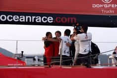 January 27, 2015. Dongfeng Race Team arrives to Sanya in first position, leader of Leg 3 after 23 days of sailing. The whole crd celebrates after crossing the finish line. - Rick Tomlinson/Volvo Ocean Race