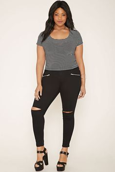 Forever 21+ - A pair of woven skinny jeans featuring ripped knees with exposed front zippers, a five-pocket construction, and a zip fly.