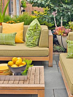Color Coordinate Just like in a home, an outdoor room really comes together when there is a cohesive color palette throughout the space. Sunny yellow accents combine flawlessly with warm, red hues found in potted plants. Colors found in nature, such as yellow and green, work well with the backyard's organic elements.