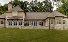 This gorgeous country retreat was influenced by traditional buildings seen in the French countryside and features a blend of Buechel stone with stucco and cedar accents. Marvin Windows & Doors. Copper roof, flashing, valleys and guttering. GAF Grand Slate Roofing Shingles in Aged Oak.