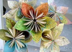 DIY Paper Flowers From Recycled Maps    I instantly fell in love with the idea. So, I tracked down a tutorial on how to make them...which basically involves old maps (or books or any paper that has otherwise outlived its original useful life).   http://www.apartmenttherapy.com/diy-paper-flowers-from-recycled-maps-165756